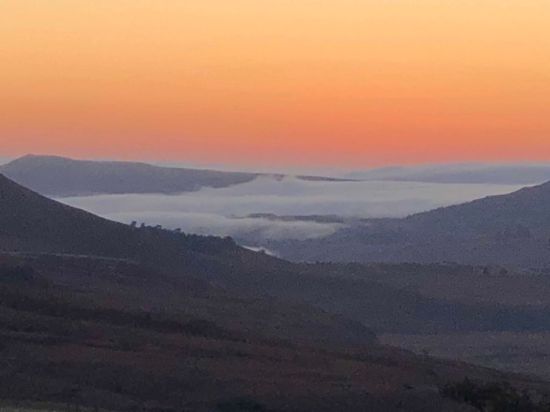 sunrise in the drakensberg at cathedral peak hotel